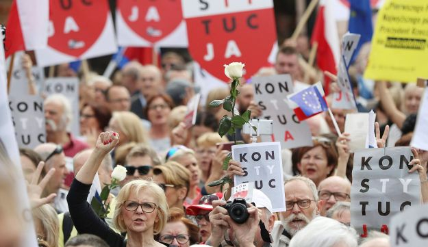 Protesters gather in front of Poland's Supreme Court building in Warsaw, Poland, Wednesday, July 4, 2018