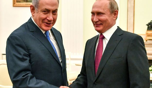 Putin shakes hands with Netanyahu during their meeting at the Kremlin in Moscow on July 11, 2018.