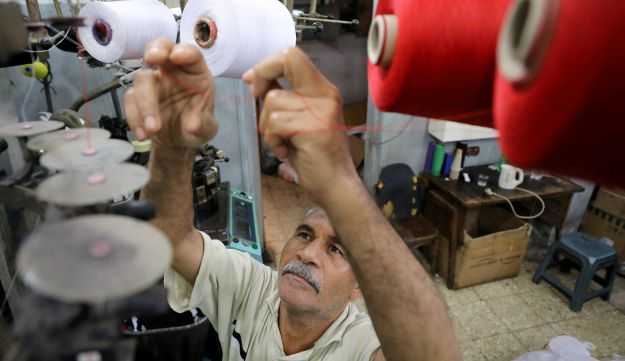 A factory employee works in a thread spinning factory in Cairo, Egypt, July 5, 2018.