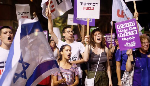 Thousands of Israelis protested on Saturday night against the passage of the nation-state bill.