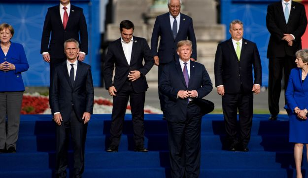 US President Donald Trump poses with Germany's Chancellor Angela Merkel, NATO Secretary General Jens Stoltenberg , Britain's Prime Minister Theresa May in a group photograph at the NATO Summit in Brussels. July 11, 2018