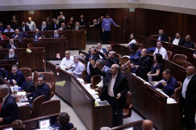 Arab lawmakers tear the nation-state bill in protest after it passes in the Knesset.