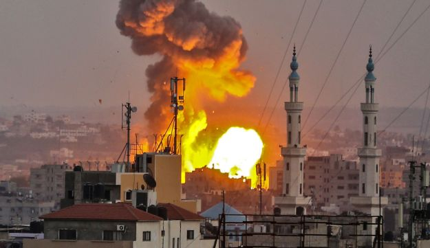 A picture taken on July 20, 2018 shows a fireball exploding in Gaza City during Israeli bombardment.