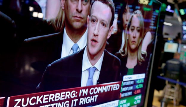 Facebook CEO Mark Zuckerberg appears on a television screen on the floor of the New York Stock Exchange as he testifies in the Senate in Washington. April 10, 2018