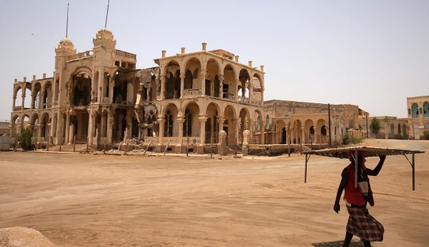 A man walking past the ruins of a building in the port city of Massawa, Eritrea, July 22, 2018.
