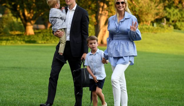 Ivanka Trump waves to the press as she walks with son Joseph, while husband Jared Kushner holds son Theodore as they exit Marine One helicopter. July 29, 2018.