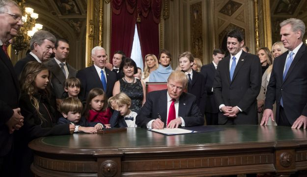 U.S. President Donald Trump formally signs his cabinet nominations into law during the 58th presidential inauguration in Washington, D.C., U.S. Jan. 20, 2017.