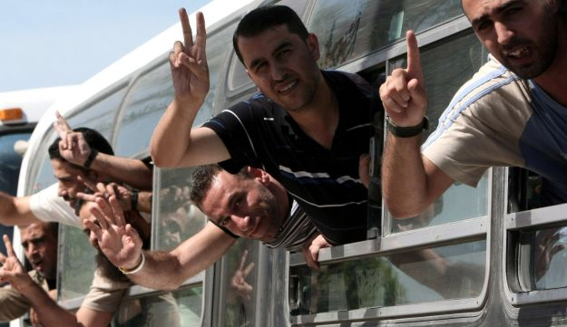 Palestinians crossing into the southern Gaza Strip after their release from Israeli prisons under a deal to free abducted Israeli soldier Gilad Shalit, October 2011.