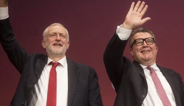Jeremy Corbyn, leader of the U.K. opposition Labour Party, left, waves with Tom Watson, deputy leader, as they arrive on stage at the Labour Party Annual Conference in Brighton, U.K., Sept. 24, 2017.