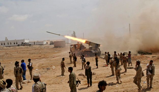 Yemeni army soldiers fire rockets at mountainous positions of al-Qaida militants at the town of Meyfaa in the southern province of Shabwa, Yemen in May 2014