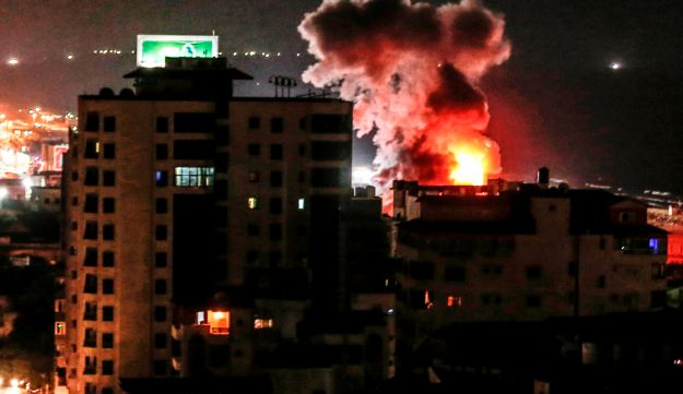 A fireball exploding during Israeli air strikes in Gaza City, August 8, 2018