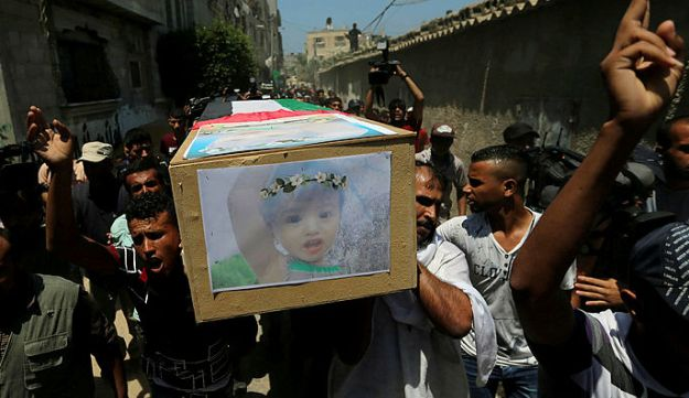 Mourners carry a coffin containing the remains of the bodies of Palestinian woman Inas Khamash and her 18-month old child Bayan, during their funeral in the central Gaza Strip August 9, 2018.