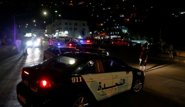Jordanian police cars are seen one day after the security incident at the city of Al Salt, Jordan, August 11, 2018.