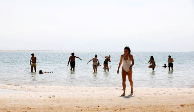 Tourists bathe at the shore of the Dead Sea, Israel July 17, 2018.