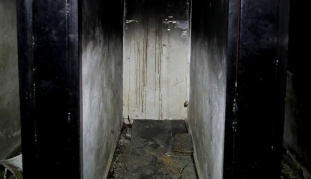 A burned underground prison cell is abandoned in Tawbeh Prison, where over the years the Army of Islam detained hundreds of people, in Douma, near the Syrian capital Damascus, Syria, July 15, 2018.