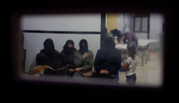 Syrian women wait in an underground hospital that insurgents referred to as Point One, in Douma, near the Syrian capital Damascus, Syria, July 15, 2018.