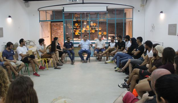 A meeting at a Tech2Peace summer academy in Yeruham, August 2018.