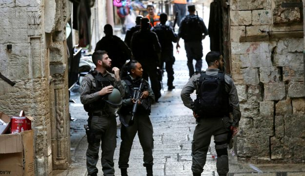 Border police officers stand near the scene of an alleged attack in the old city of Jerusalem, August 17, 2018.