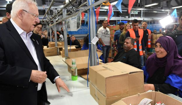 President Reuven Rivlin visits a SodaStream manufacturing plant in the Bedouin town of Rahat, southern Israel, June 25, 2018.