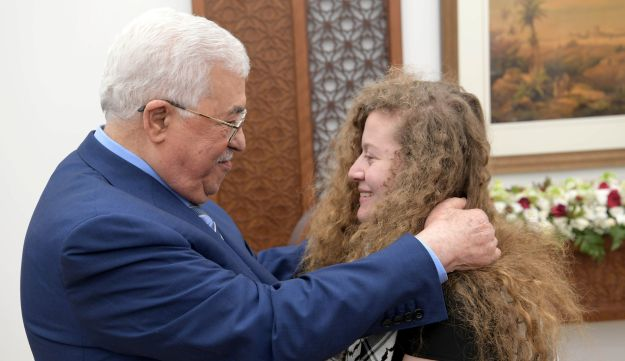 Palestinian President Mahmoud Abbas and Ahed Tamimi.