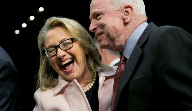 John McCain and Hillary Clinton talk prior to a Senate Foreign Relations Committee nomination hearing in Washington, D.C., January 24, 2013.