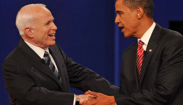 Barack Obama and John McCain greet each other at the end of their third and final presidential debate, Hempstead, New York, 2008.