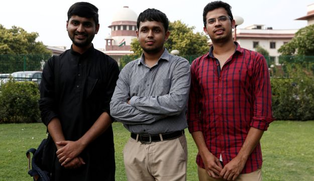 Anwesh Pokkuluri, Romel Barel and Krishna Reddy M, petitioners challenging Section 377 of the Indian Penal Code that criminalizes homosexuality, pose outside the premises of the Supreme Court in New Delhi, India, July 10, 2018.