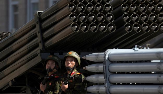 Soldiers sit on a rocket launcher vehicle during a parade for the 70th anniversary of North Korea's founding day in Pyongyang, North Korea, September 9, 2018.