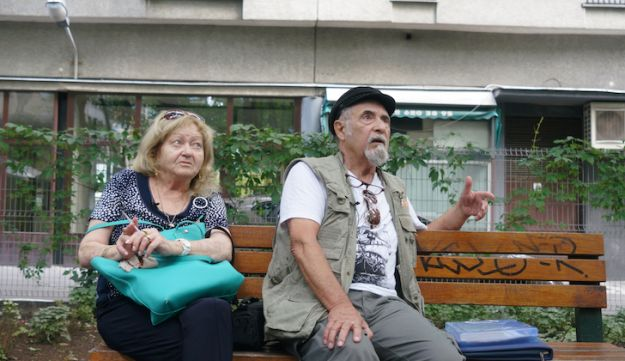 Sztykgold and wife Liora rest in a park that was built on the site of what used to be his childhood home in Warsaw, September 5, 2018.