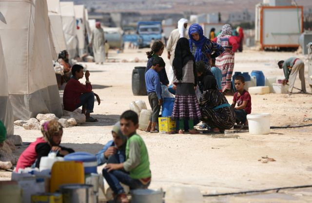People who fled Syria's Idlib province are pictured at a camp in Kafr Lusin near the border with Turkey in the northern part of the province on September 9, 2018.