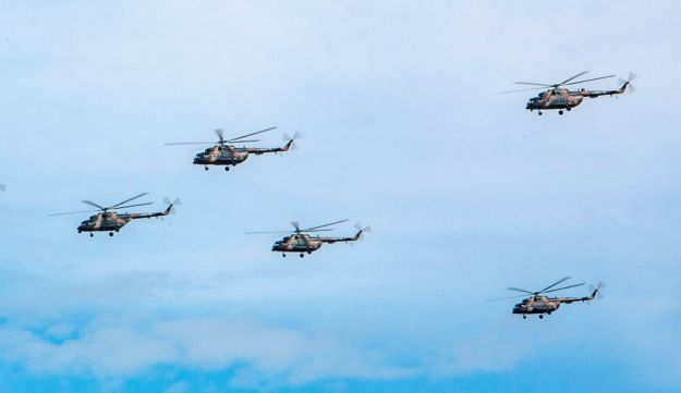 Russian military helicopters flying in the Chita region in Eastern Siberia during the Vostok 2018 exercise, September 11, 2018.