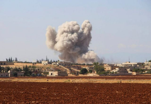 Smoke rising from a Syrian government airstrike in Hobeit village, near Idlib, September 10, 2018.
