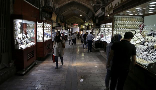 People visit a gold market at the Grand Bazaar in Tehran, Iran, August 13, 2018