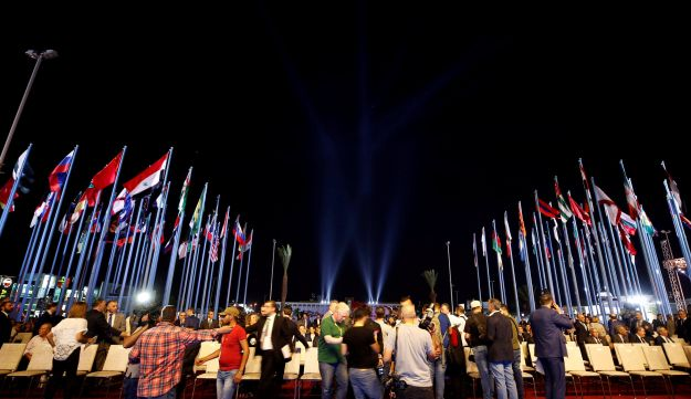 People gather during the opening ceremony of the 60th edition of the annual Damascus International Fair, Syria September 6, 2018