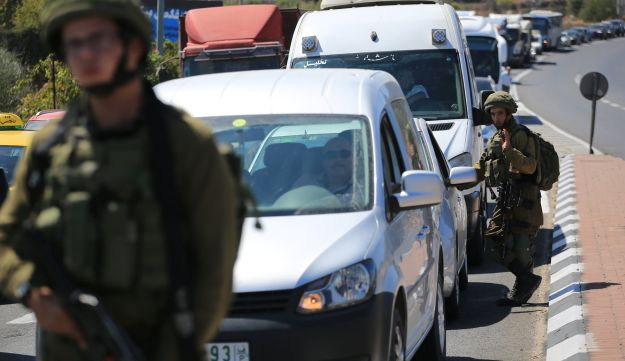 Soldiers are seen stationed at Gush Etzion Junction, West Bank, September 16, 2018.