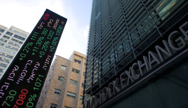 FILE PHOTO: An electronic board displaying market data is seen at the entrance of the Tel Aviv Stock Exchange, in Tel Aviv, Israel January 29, 2017.
