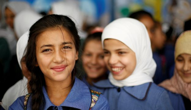 Refugee schoolchildren attend an official ceremony to return to school at one of the UNRWA schools at a Palestinian refugee camp al Wehdat, in Amman, Jordan, September 2, 2018