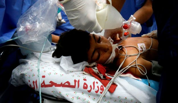 Yousef Abu Zarifa, 11, wounded during clashes along the Israel-Gaza border, receives treatment at a hospital in Khan Younis, southern Gaza, September 28, 2018.