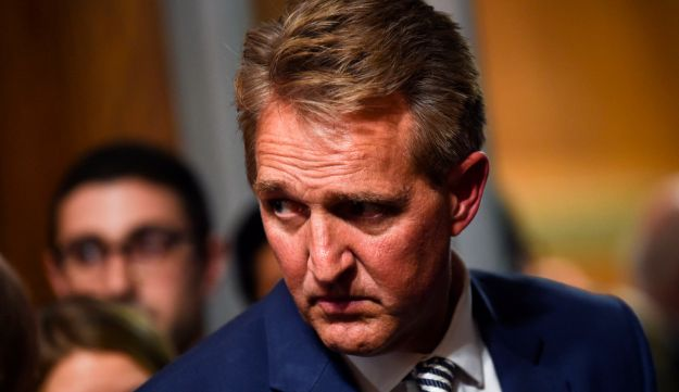Senate Judiciary Committee member Jeff Flake (R-AZ) looks on after a hearing on Capitol Hill in Washington, DC on September 28, 2018