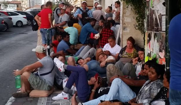 Asylum seekers queue outside the offices of the interior ministry in Tel Aviv.