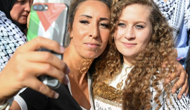 Ahed Tamimi raking a selfie with a woman at a music festival in a Paris suburb, September 16, 2018.