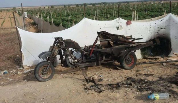 A Palestinian motorbike that was damaged by the Israeli strike on the group that launched flammable balloons southern Gaza on October 20, 2018.