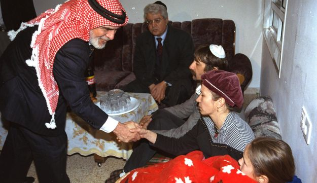 King Hussein of Jordan consoling Israeli family whose daughter was killed by a Jordanian soldier in Naharyim, 2007