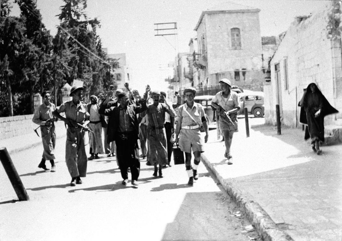 IDF soldiers guarding Palestinians in Ramle, in 1948