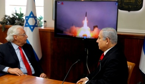 Israeli Prime Minister Benjamin Netanyahu and US Ambassador to Israel David Friedman watch a video showing the launch of the Arrow 3 anti-ballistic missile during a cabinet meeting in Jerusalem. July 28 2019