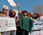 Palestinian women protest in support of women's rights outside the prime minister's office in the We