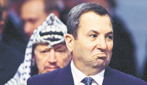 Then-Israeli Prime Minister Ehud Barak stands in front of Palestinian leader Yasser Arafat after a memorial ceremony for Yitzhak Rabin in Oslo, Norway. November 2, 1999
