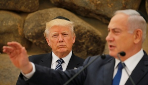 Israel's Prime Minister Benjamin Netanyahu compliments U.S. President Donald Trump on having been the first sitting U.S. president to leave a prayer at the Western Wall, during remarks at the Yad Vashem holocaust memorial in Jerusalem May 23, 2017.