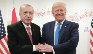 Turkey's President Recep Tayyip Erdogan and U.S. President Donald Trump shake hands during a meeting on the sidelines of the G-20 summit in Osaka, Japan. June 29, 2019