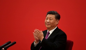 Xi Jinping applauds to Russian President Vladimir Putin as they talk via a video link, from the Great Hall of the People in Beijing, December 2, 2019.
